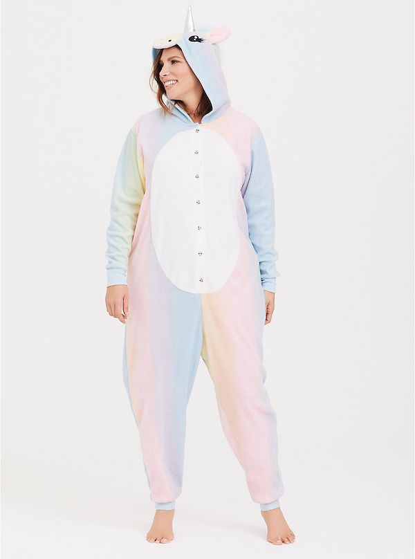 A model wearing a plus-size unicorn onesie.