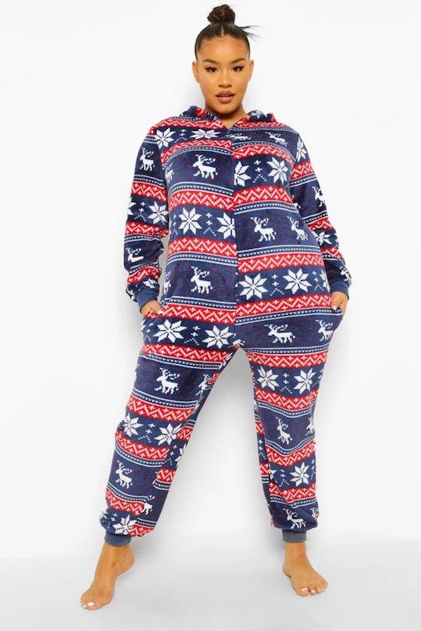 A model wearing a plus-size fair isle onsie.