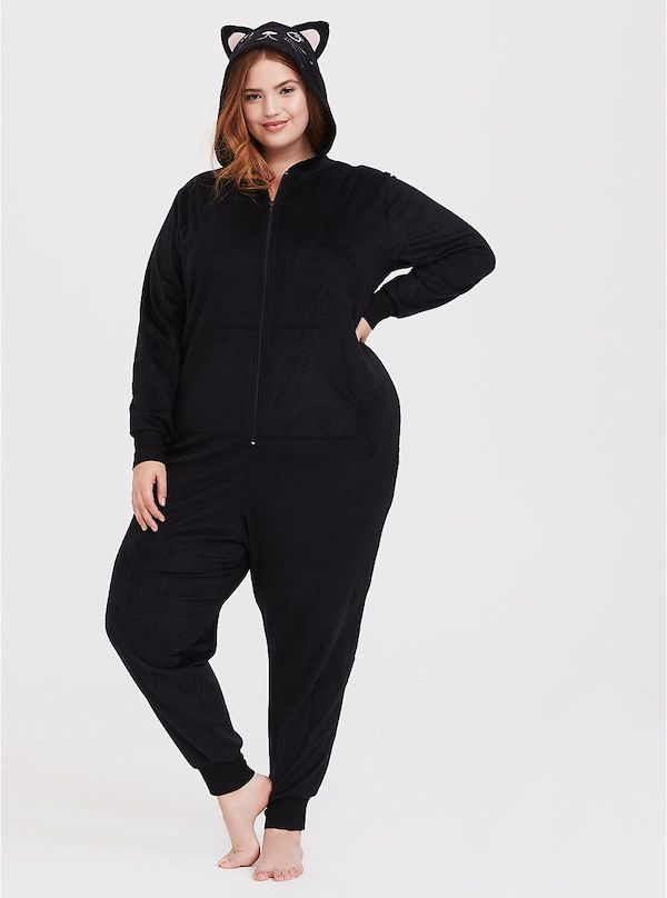 A model wearing a plus-size black cat onesie.