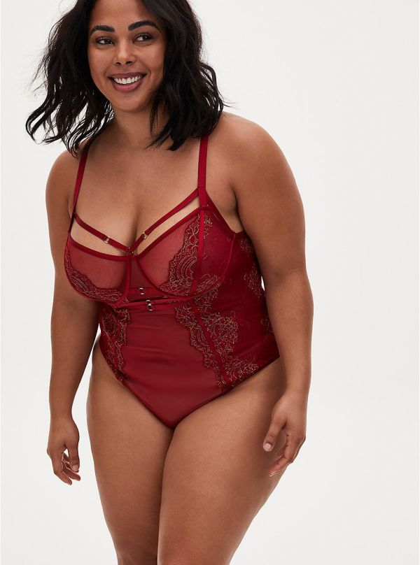 A model wearing a plus-size red lingerie bodysuit.