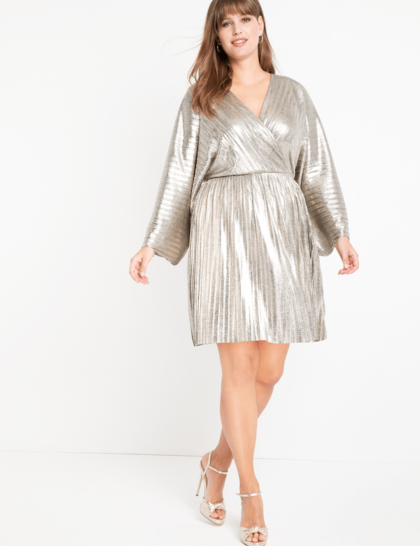 A model wearing a plus-size silver minim dress.