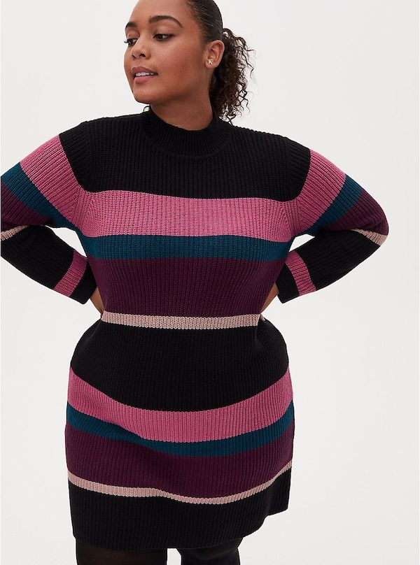 A model wearing a plus-size purple and pink stripe sweater dress.