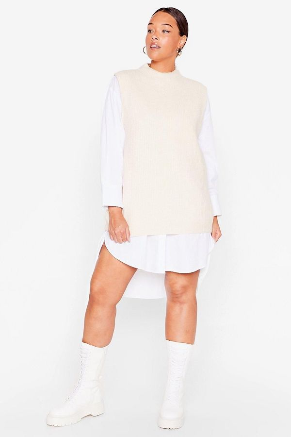 A model wearing a plus-size cream sweater vest.