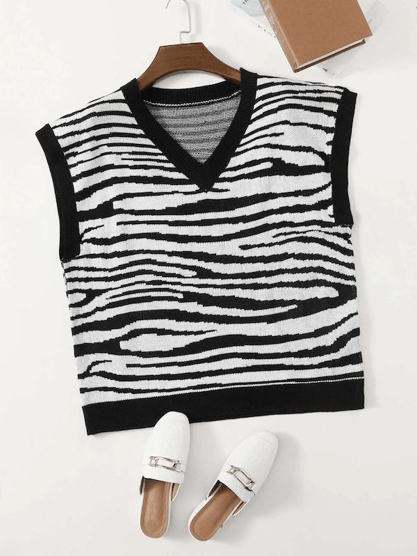 A plus-size sweater vest in zebra stripes.