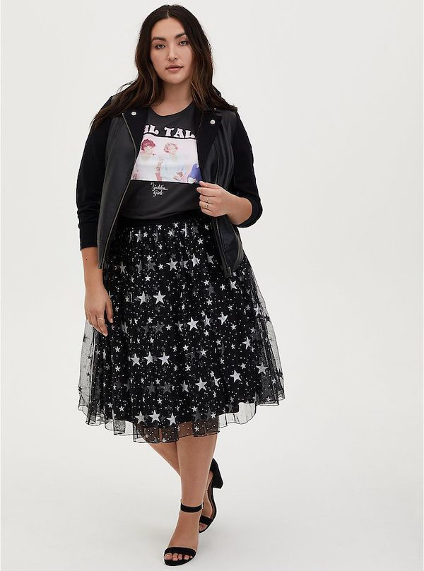 A model wearing a plus-size black tulle skirt with stars.