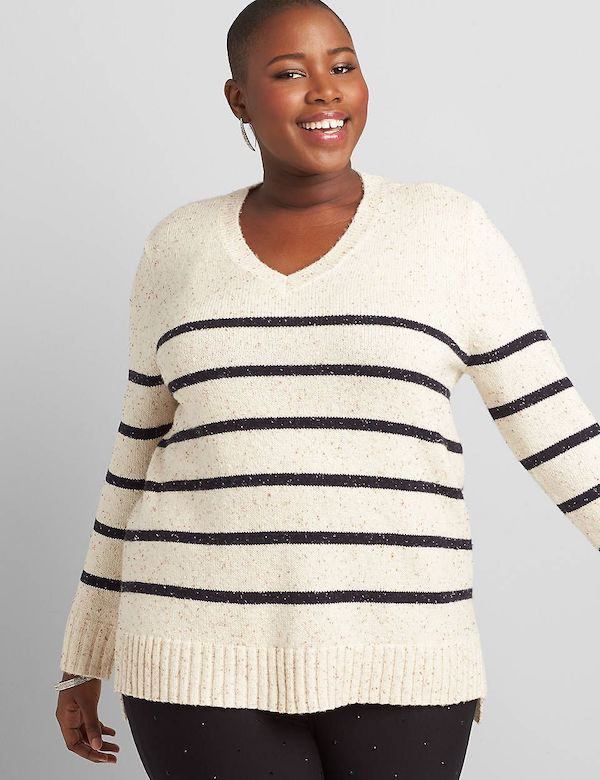 A model wearing a plus-size v-neck sweater in black and white stripe.