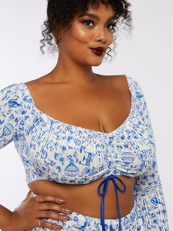 A model wearing plus-size blue and white velvet lingerie.