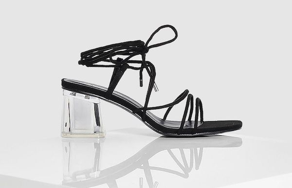 Strappy black heels with clear heel.