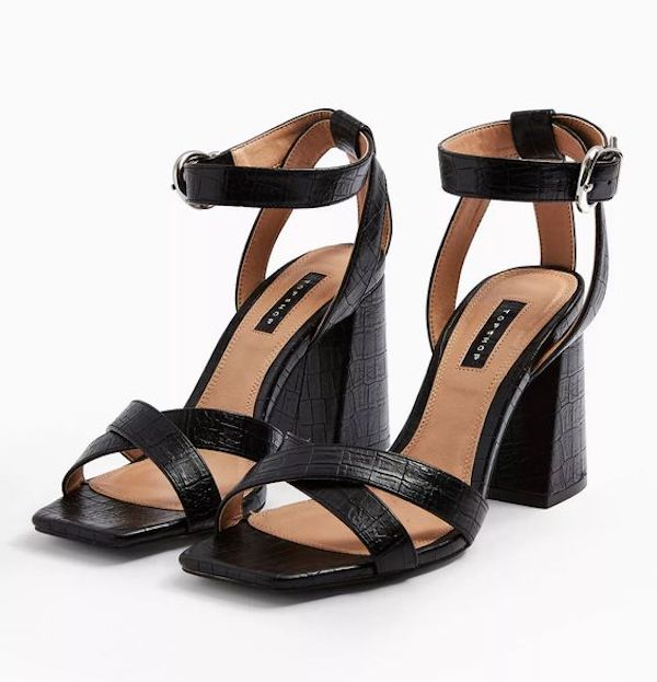A pair of black wide-fit heels.