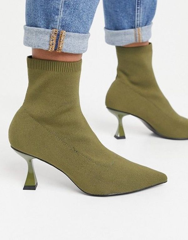 A pair of green heeled booties.