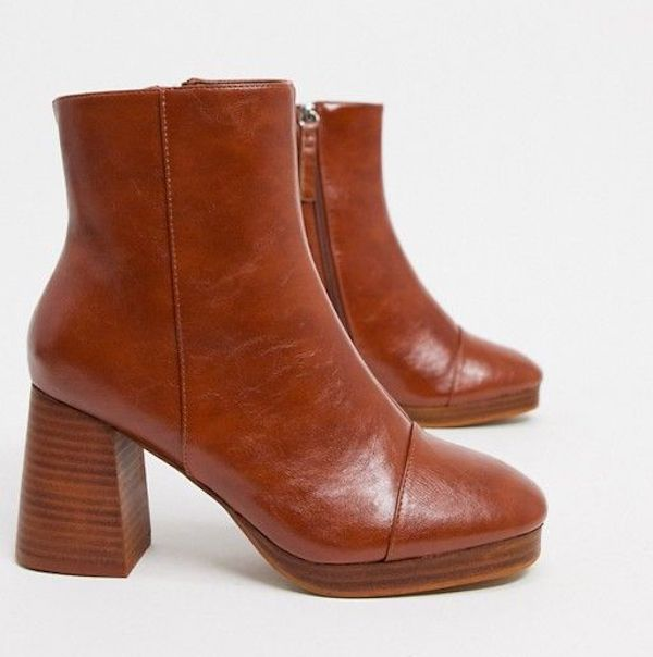 A pair of brown heeled booties.