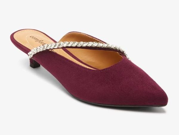 A pair of wide-fit mules in burgundy.
