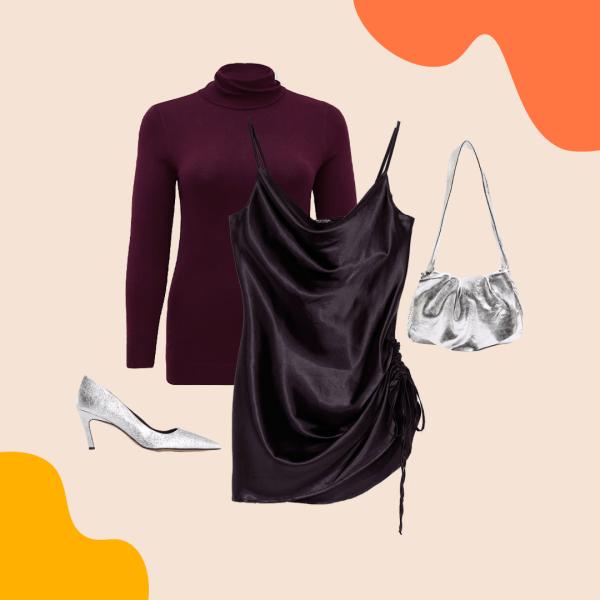A dark purple turtleneck, black slip dress, silver heels, and silver purse.