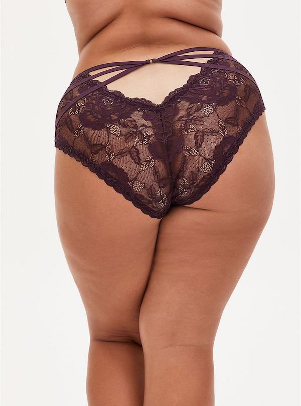 A model wearing a plus-size cage panties in burgundy.