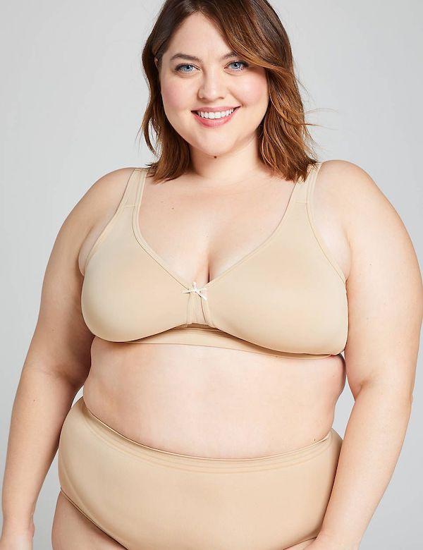 A model wearing a plus-size wire-free bra in beige.