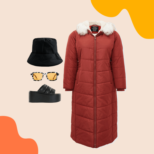 A red long puffer coat, black puffer bucket hat, black puffer sandals, and sunglasses.