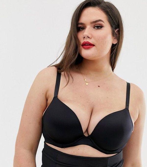 A model wearing a plus-size push-up bra in black.