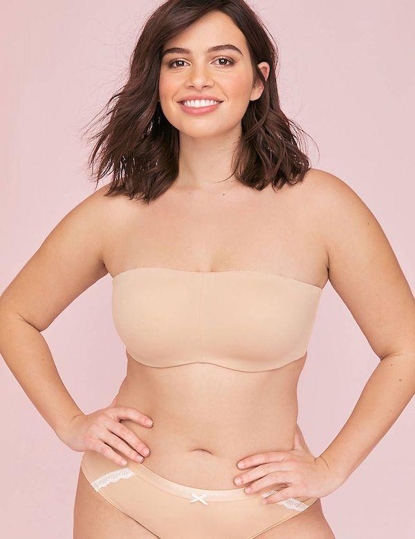 A model wearing a plus-size strapless bra in beige.