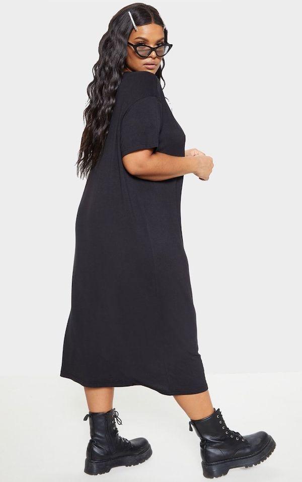A model wearing a plus-size t-shirt dress in black.