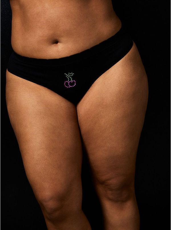 A model wearing a plus-size thong in black.