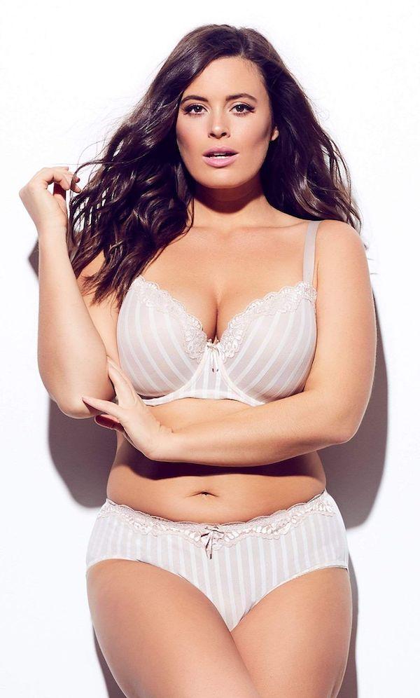 A model wearing a plus-size white bra.