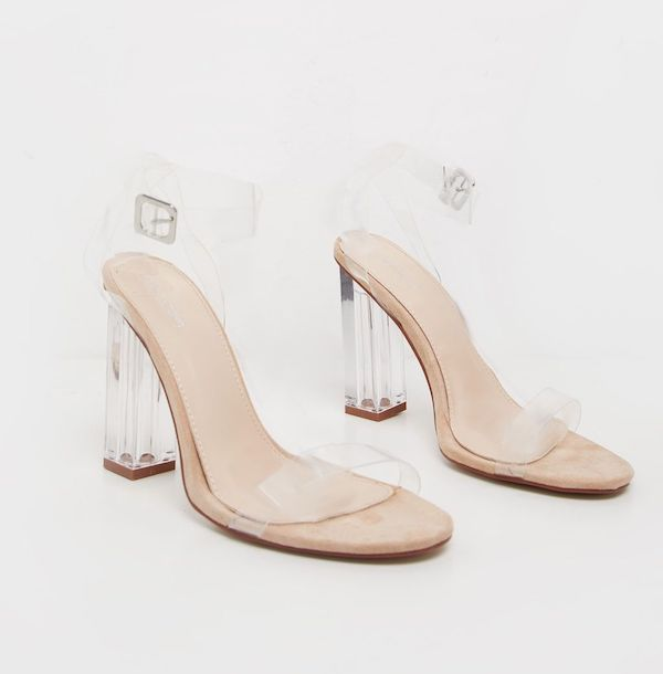 A pair of wide-fit block heels in clear.