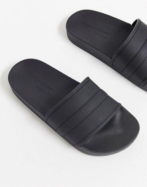Wide-fit slide sandals in black.