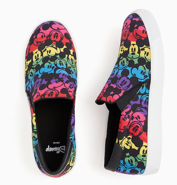 Wide-fit slip-on sneakers in rainbow with Mickey Mouse pattern.