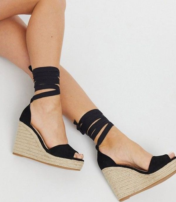 A pair of wide-fit wedges in black.