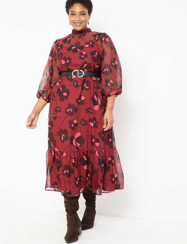 A model wearing a plus-size maxi dress in red floral print.
