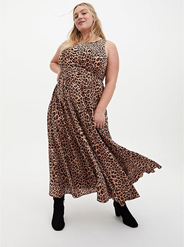 A model wearing a plus-size maxi dress in leopard print.