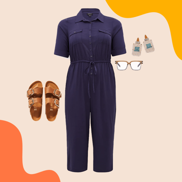 A navy utility jumpsuit, brown sandals, blue light glasses, and glue bottle earrings.