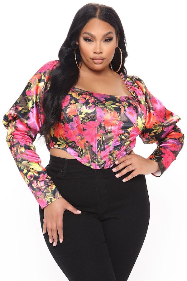 A model wearing a plus-size bustier top in floral.