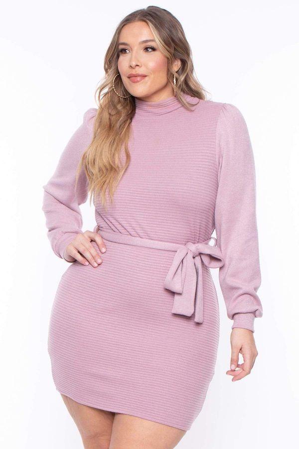 A model wearing a plus-size mini dress in light purple.