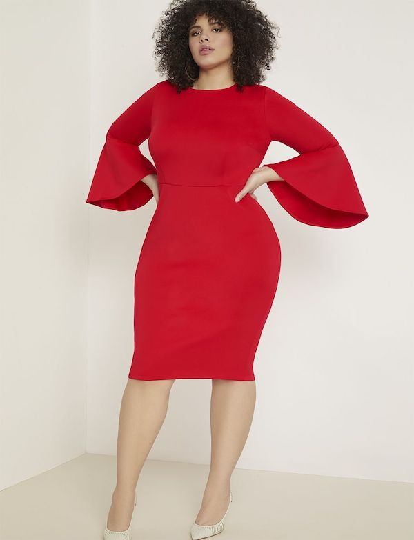 A model wearing a plus-size midi dress in red.