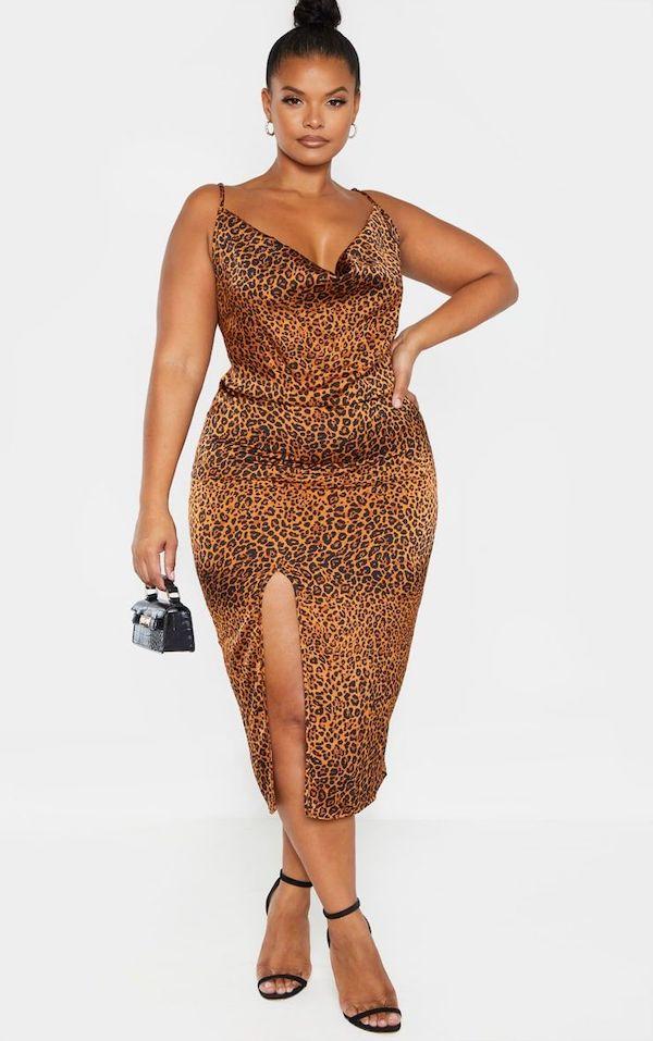 A model wearing a plus-size midi dress in leopard print.