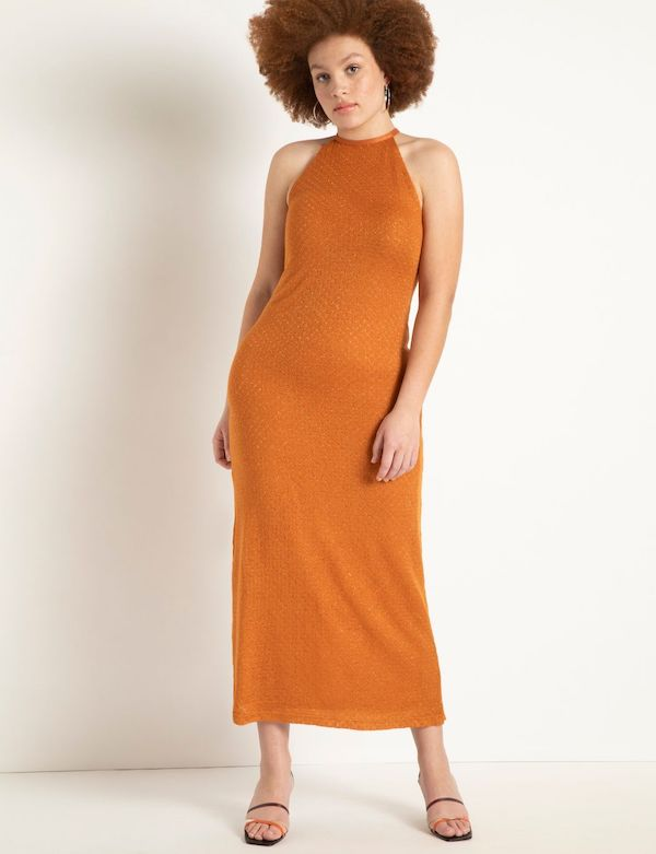 A model wearing a plus-size halter dress in orange.