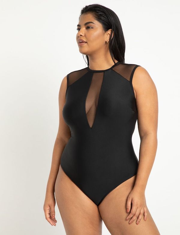 A model wearing a plus-size high-neck swimsuit in black.