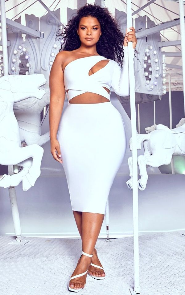 A model wearing a plus-size one-shoulder dress in white.