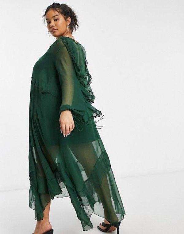 A model wearing a plus-size ruffle dress in green.