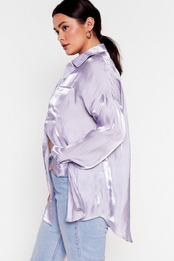 A model wearing a plus-size satin button down in lavender.