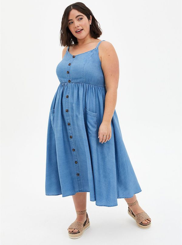 A model wearing a plus-size summer dress.