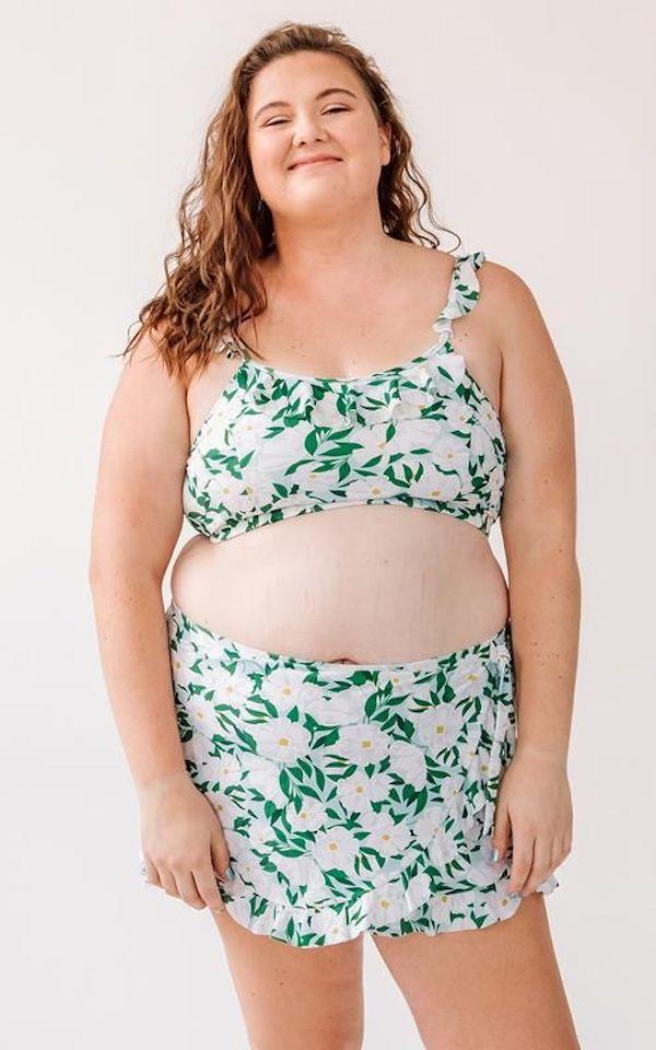 A model wearing a plus-size swim skirt.