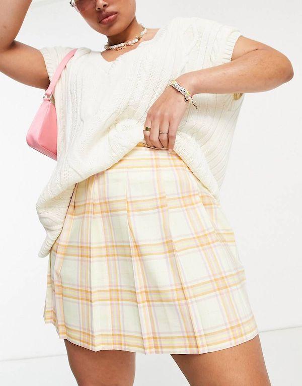A model wearing a plus-size tennis skirt