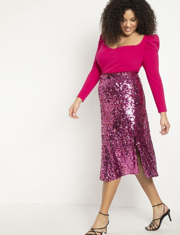 A model wearing a plus-size pink sequin skirt from ELOQUII.