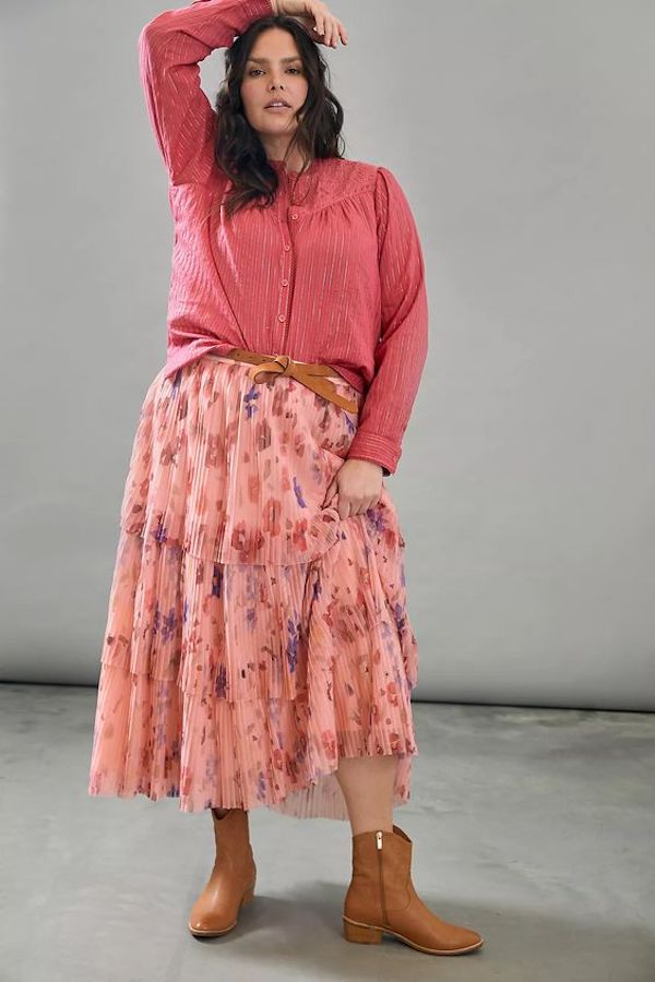 A model wearing a plus-size floral skirt.