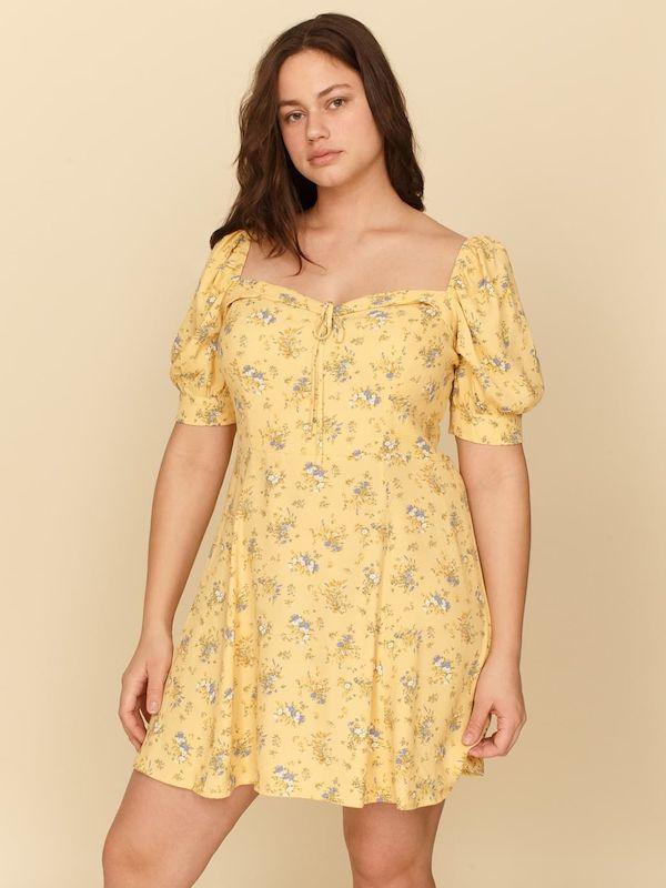 A model wearing a plus-size milkmaid dress.