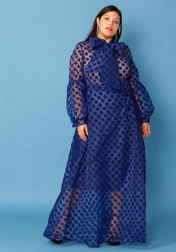 A model wearing a plus-size organza dress.