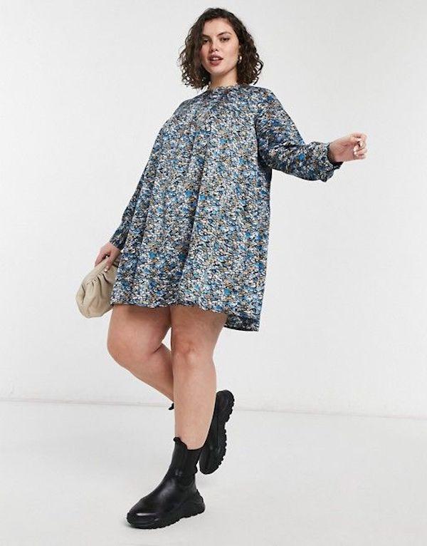 A model wearing a plus-size spring dress.