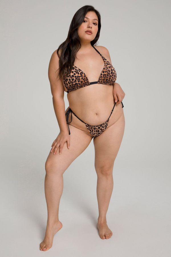 A model wearing a plus-size animal print swimsuit.